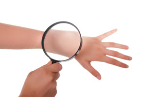 Image of a magnifying glass on an arm.